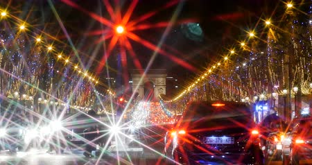oblouk : PARIS, FRANCE - CIRCA 2016: Timelapse fast motion  Traffic jam on the busy Champs-Elysees boulevard in Paris, France with lots of cars and pedestrians waiting to commute