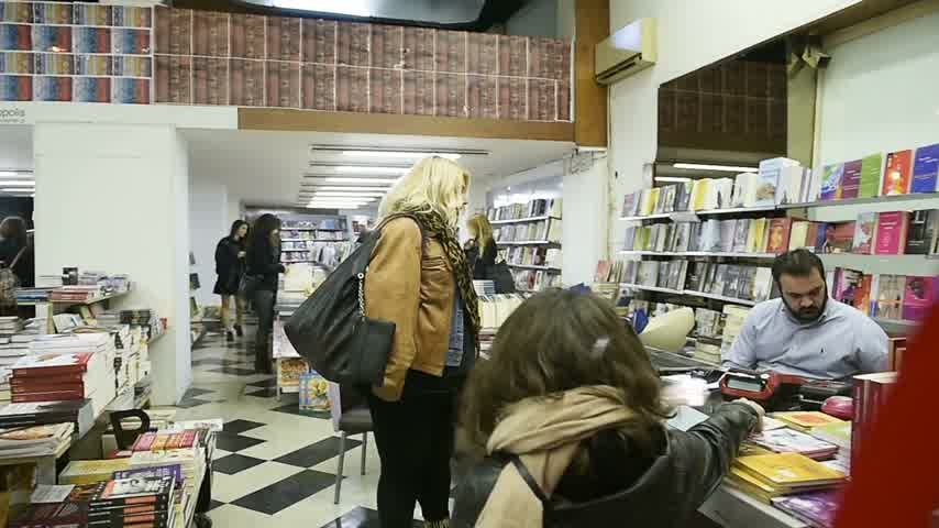 bookshop : ATHENS, GREECE - CIRCA 2016: People buying books from library at night sale party delivered by one of the most central bookshops in central Athens, Greece