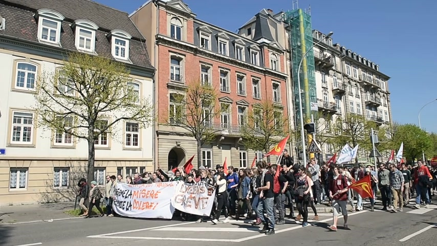 vosges : STRASBOURG, FRANCE - APR 20, 2016: Closed Avenue des Vosges as hundreds of people demonstrate as part of nationwide day of protest against proposed labor reforms by Socialist Government