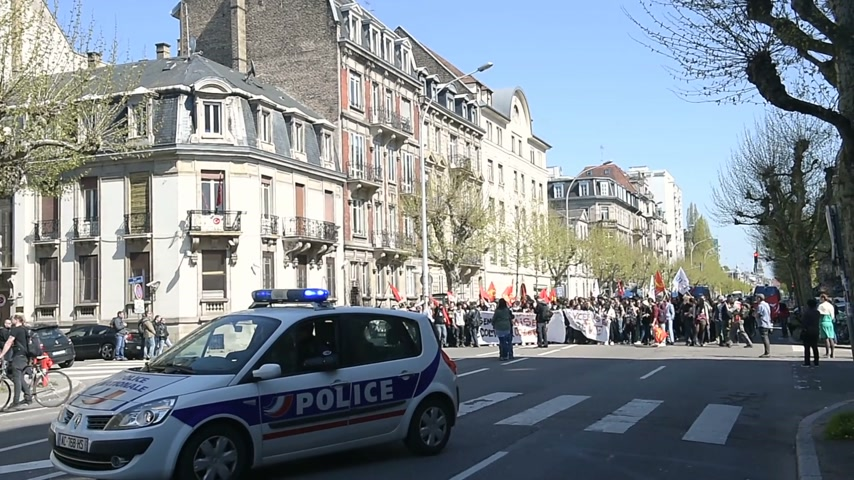 vosges : STRASBOURG, FRANCE - APR 20, 2016: Closed Avenue des Vosges as hundreds of people demonstrate as part of nationwide day of protest against proposed labor reforms by Socialist Government in front of Turkey Consulate