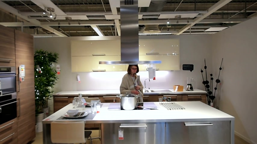 kitchen furniture : PARIS, FRANCE - APR 12, 2016: Motion over woman choosing modern kitchen furniture and kitchen appliances in the modern IKEA shopping furniture mall in Paris