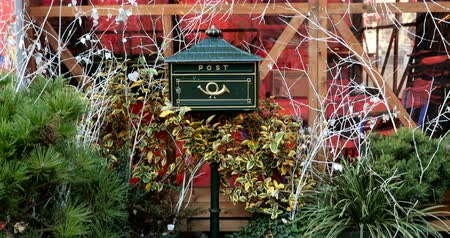 postabélyegző : Christmas letter box to Santa with Christmas tree and Christmas Market in the background