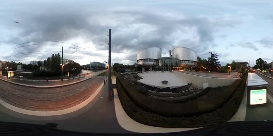 european court of human rights : STRASBOURG, FRANCE - CIRCA 2016: 360 VR image of 360 VR image of European Parliament and European Court of Human Rights at dusk in Strasbourg, France - 360 VR film Stock Footage