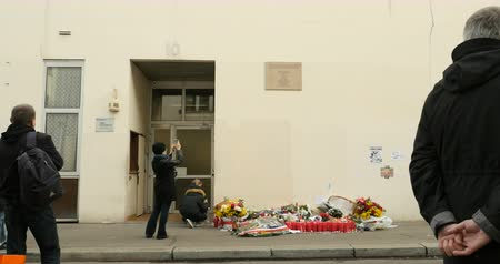 je suis charlie : PARIS, FRANCE - CIRCA 2016: Crowd of people mourning, putting flowers and candles after Paris attacks at the headquarter of Charlie Hebdo magazine at Rue Nicolas Appert