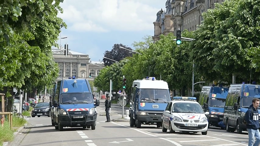 protestor : STRASBOURG, FRANCE - MAY 19, 2016: Police van closing boulevard at demonstrations against proposed French governments labor and employment law reform