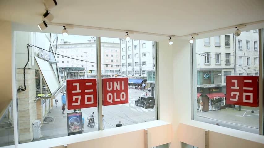 uniqlo : STRASBOURG, FRANCE - CIRCA 2016: Uniqlo Co., Ltd. storewith people entering the building. Uniqlo is a Japanese casual wear designer, manufacturer and retailer.