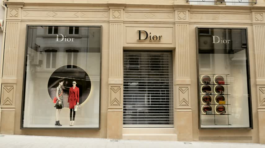 perfume bottle : LUXEMBOURG, LUXEMBOURG - CIRCA 2016: People admiring luxury fashion DIOR store in central Luxembourg on 16 Rue Philippe II