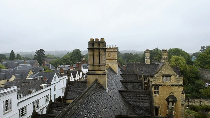 cambridge : Aerial view over rainy Oxford roofs from the windows of the New College - Oxford university footage. Stock Footage