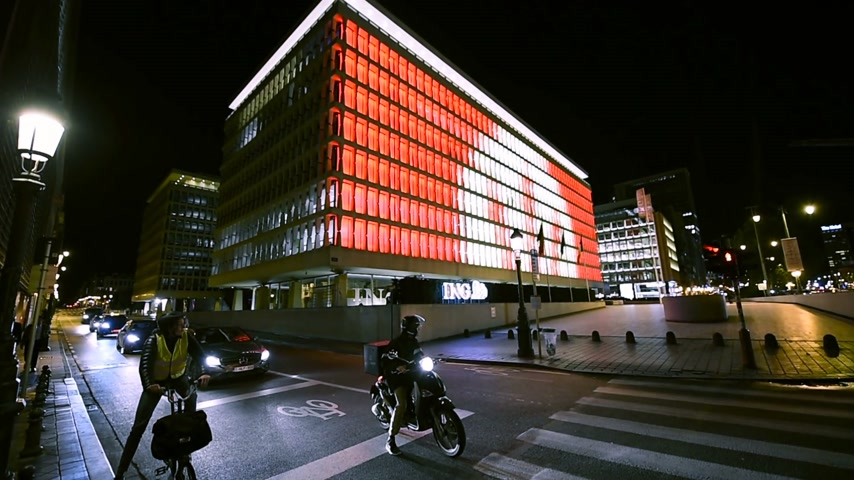 ing : BRUSSELS, BELGIUM - Circa 2016: ING Bank headquarter in central business district of Bruxelles at night with traffic avenue. The ING Group is a Dutch multinational banking and financial services corporation headquartered in Amsterdam