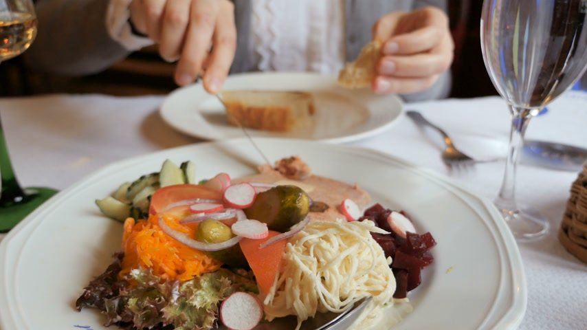 alsatian : Woman eating in Alsacian Restaurant pork terrine