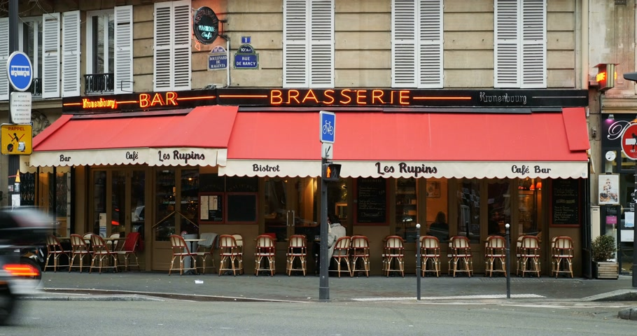 alsatian : PARIS, FRANCE - CIRCA 2016: Beer bar pub Les Rupins on Paris streets with outdoor terrace and neon light advertising selling Kronenbourg Alsatian beer Stock Footage