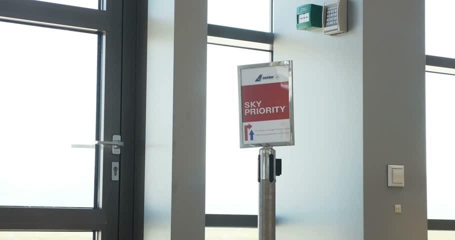 proceed : SIBIU, ROMANIA - CIRCA 2016: Sky Priority sign with instruction for airport passengers inside Sibiu International airport, Romania Tarom