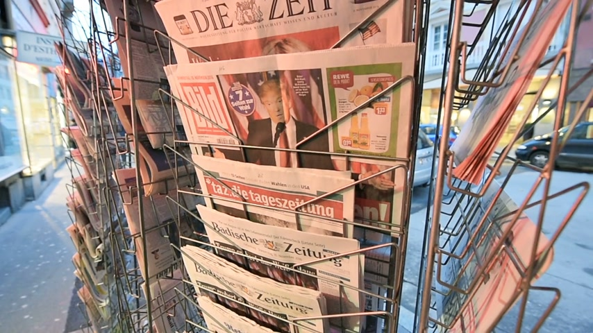 donald trump : PARIS, FRANCE - NOV 10, 2016: German press with shocking headline title at press kiosk about the US President Elections - Donald Trump is the 45th President of United States of America
