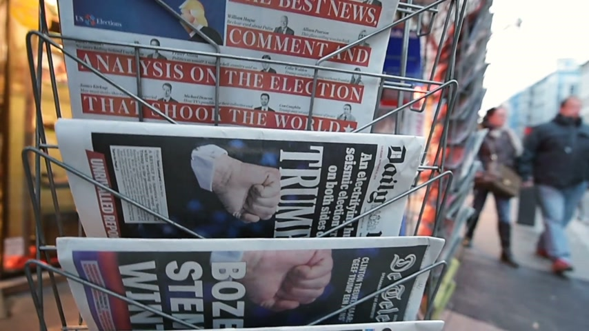donald trump : PARIS, FRANCE - NOV 10, 2016: Man buying Daily Mail newspaper with shocking headline title at press kiosk about the US President Elections - Donald Trump is the 45th President of United States of America