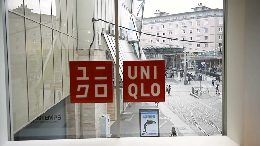 uniqlo : STRASBOURG, FRANCE - CIRCA 2016: Uniqlo Co., Ltd. store with people entering the building. Uniqlo is a Japanese casual wear designer, manufacturer and retailer.