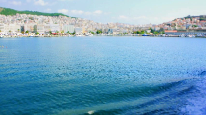 zár : Tilt-shift miniature effect view from ferry approaching to the Thessaloniki city in Greece on a summer day