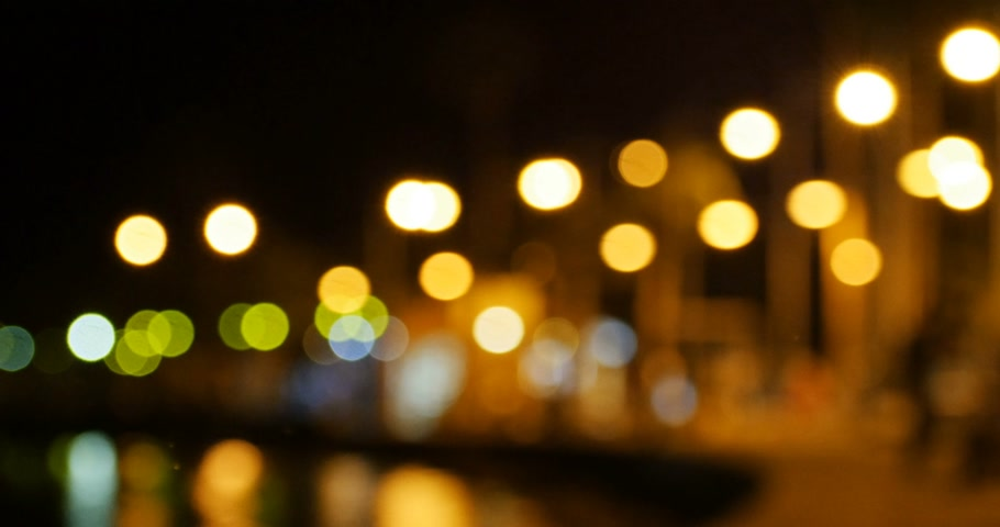 ciprus : Defocused view with beautiful Bokeh in the city of Paphos, Cyprus at night with cars driving people walking and house lights Stock mozgókép