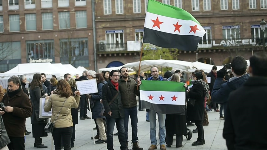 bashar al assad : STRASBOURG, FRANCE - MAR 19, 2016: Syrian diaspora protests in center of Strasbourg to denouncing the Syrian attacks and show solidarity Syrian people
