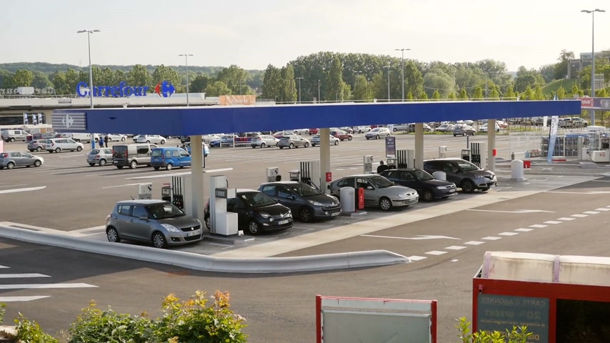 literário : LIsle-dAbeau, France - Circa 2017: Still elevated view of self French gas station at Carrefour Hypermarket zone with cars filling gas and diesel for the best price in town Stock Footage