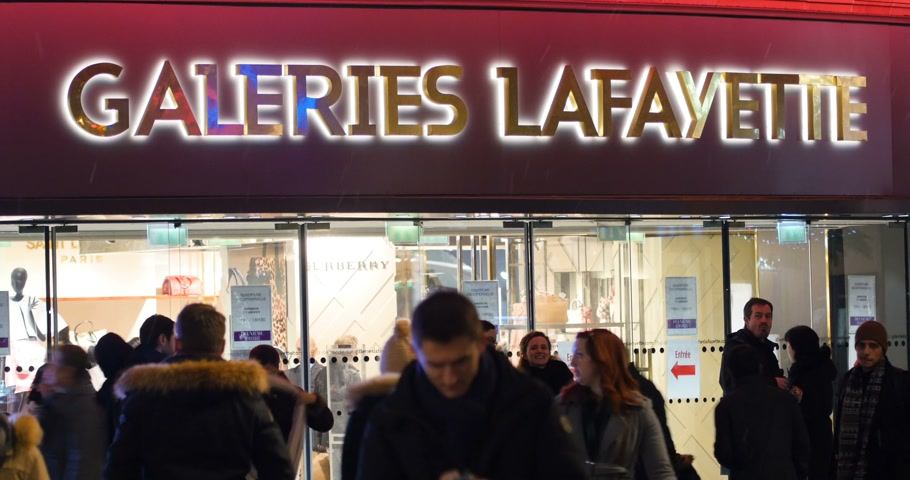 lafayette : STRASBOURG, FRANCE - CIRCA 2016: Famous Galleries Lafayette store in French city of Strasbourg with customers and sudden first winter snow Stock Footage