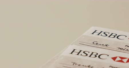 checkbook : PARIS, FRANCE - CIRCA 2017: Two HSBC banking checks on table. HSBC Holdings PLC is a British multinational banking and financial services holding company headquartered in London, United Kingdom. It is the worlds sixth largest bank by total assets with to