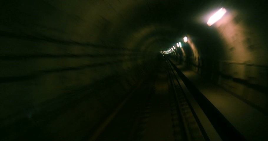 underground tunnel : Point of view of passenger inside train trying to escape from something inside metro tube Stock Footage