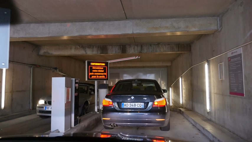 множество : STRASBOURG, FRANCE - CIRCA 2017: Passenger point of view of driver entering the underground parking waiting in line at the barrier taking the ticket at the electronic ticket system
