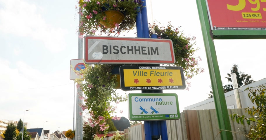 trave : Bischheim Strasbourg - Circa 2016: Entrance to Bischeim with pedestrians, cars and Renault parked car. Bischheim is a commune in the Bas-Rhin department in Grand Est in northeastern France