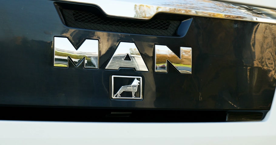 augsburg : MUNICH, GERMANY - CIRCA 2017: Close-up of the chrome MAN truck logotype. MAN Truck & Bus AG Nutzfahrzeuge AG,  is the largest subsidiary of the MAN SE corporation, and one of the leading international providers of commercial vehicles Stock Footage