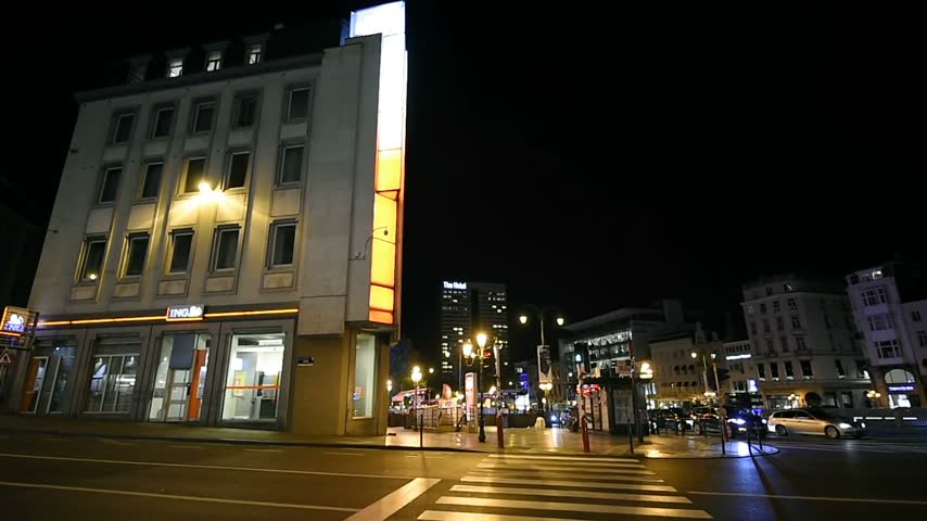 ing : BRUSSELS, BELGIUM - CIRCA 2016: Night view over Avenue de la Toison dOr Brussels with The Hotel building in the background, cars, banks and typical Brussels architecture