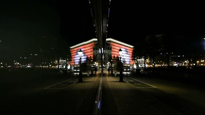 ing : BRUSSELS, BELGIUM - CIRCA 2016: ING Bank headquarter in central business district of Brussels at night with traffic avenue - abstract reflection in glass facade