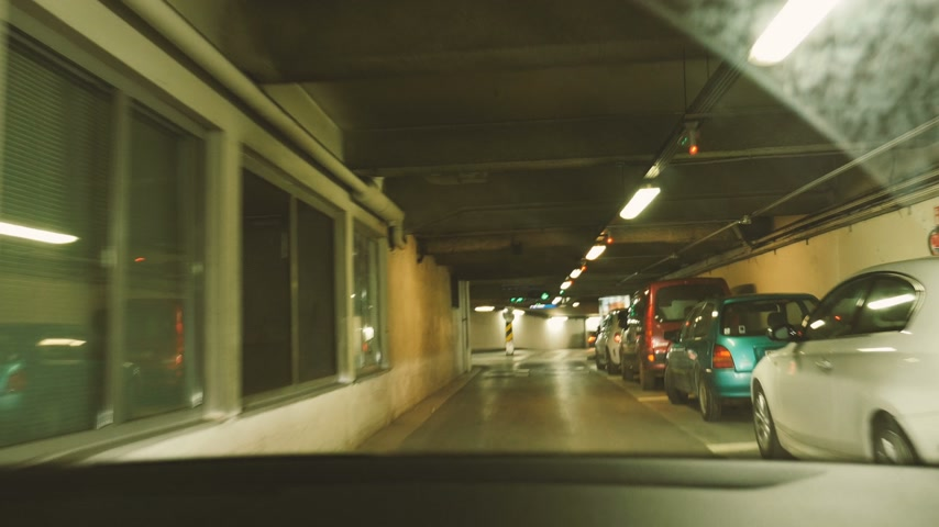 garagem : PARIS, FRANCE - CIRCA 2017: Driver point of view driving in underground parking searching for the parking place