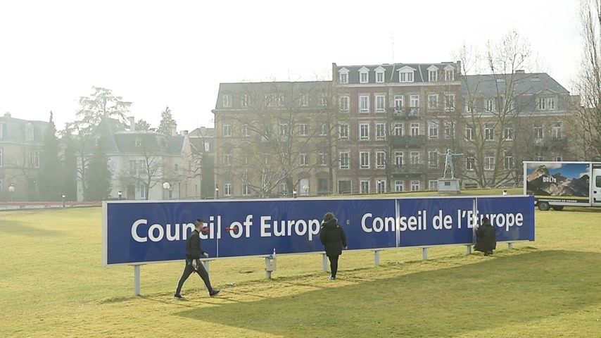 coe : STRASBOURG, FRANCE - FEB 2, 2017: Workers taking care of the Council of Europe Conceil de Europe blue signage in front of the international organisation focused on promoting human rights, democracy and the rule of law in Europe