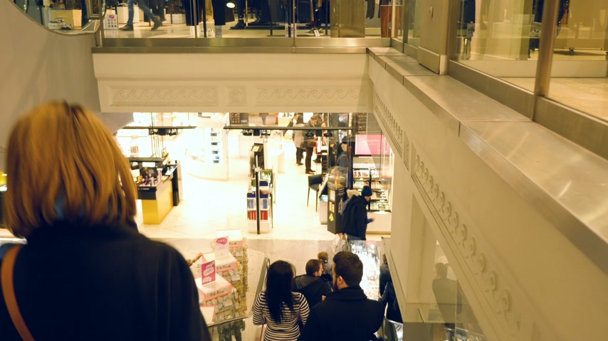lafayette : STRASBOURG, FRANCE - CIRCA 2017: Group of people descending ascending the escalator stairs of the fashion store Galeries Lafayette In Strasbourg, France - the luxury upmarket French department