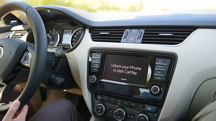 unlocking : PARIS, FRANCE - CIRCA 2017: Man unlocking iPhone to start using Apple CarPlay main screen in modern car dashboard. CarPlay is an Apple standard that enables a car radio or head unit to be a display and controller for an iPhone. It is available on all iPho Stock Footage