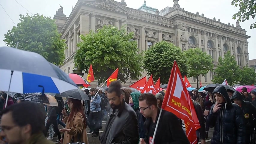 résztvevő : STRASBOURG, FRANCE - MAY 12, 2016: Raining at protest - CGT France - General Confederation of Labour demonstrate as part of nationwide day of protest against labor reforms by France Government Stock mozgókép
