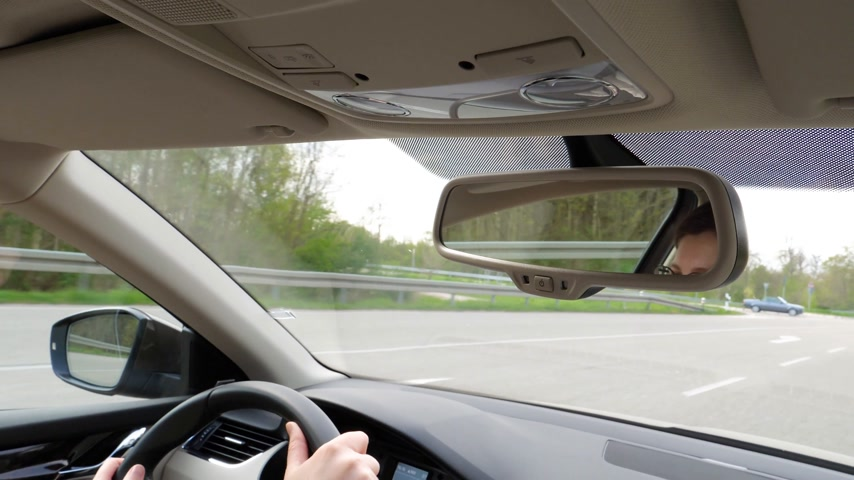 butterflies in the stomach : Car interior view of woman driving car on German autobahn in Baden-Wurttemberg Land