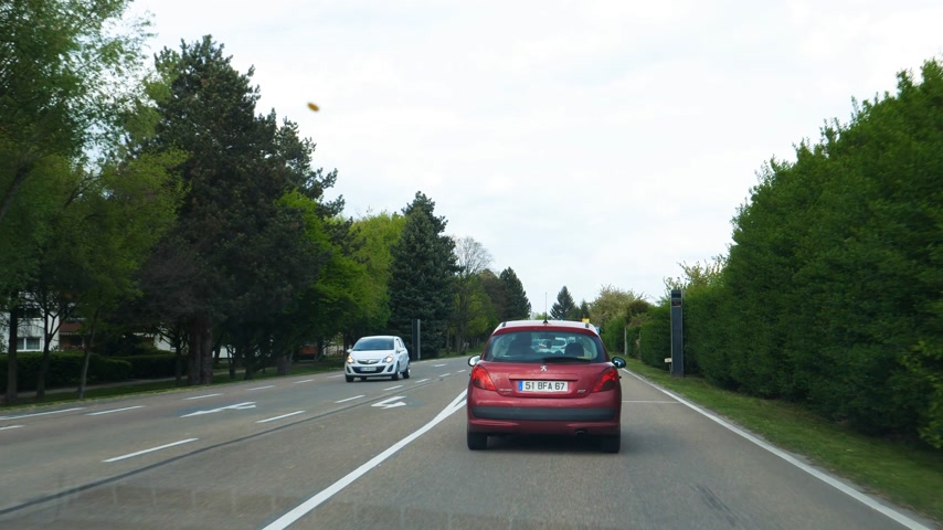 příjezdová cesta : RASTATT, GERMANY - CIRCA 2017: Driver point of view personal perspective following Peugeot car with French plates numbers in German city of Rastatt Dostupné videozáznamy