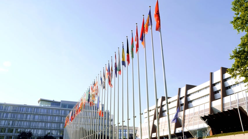 flag half mast : STRASBOURG, FRANCE - MAY 26, 2017: European Union and the United Kingdom flags fly half-mast Council of Europe building memory of victims terrorist explosion Manchester Arena