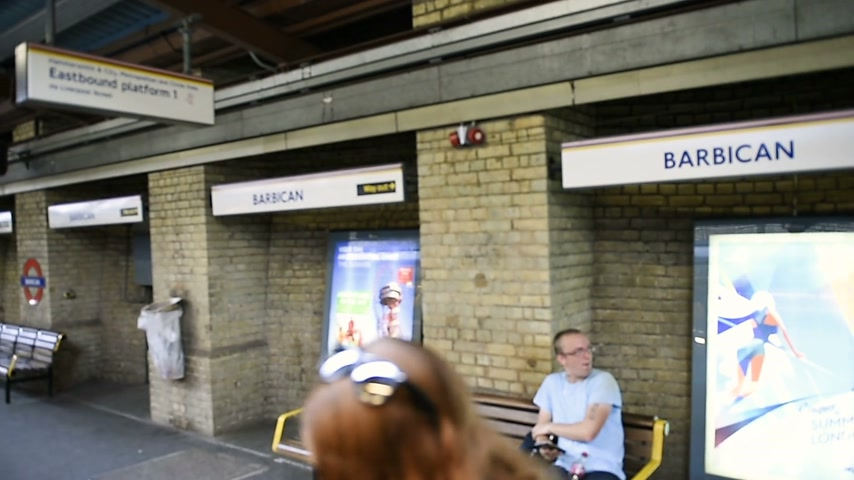 mind the gap : LONDON, UNITED KINGDOM - CIRCA 2017: This is Barbican sound station in London arriving in station arrival at destination metro train tube commuters waiting at station enter train - going to work going home travel and visiting London