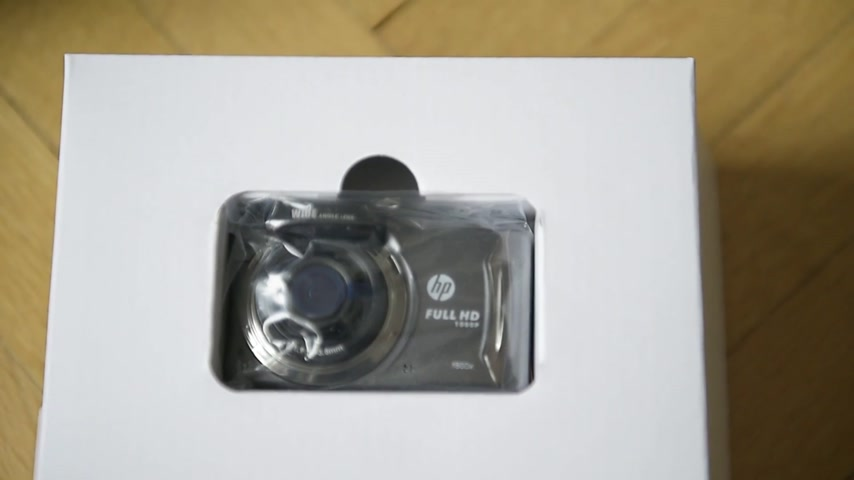 бортовой : PARIS, FRANCE - CIRCA 2017: Unboxing unpacking of the new car dashboard dash camera from HP Hewlett-Packard