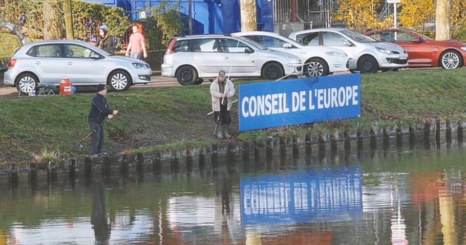 european court of human rights : STRASBOURG, FRANCE -CIR CA 2016: Fishermans fishing at the next to the Council of Europe signage and Council of Europe building in Strasbourg, France
