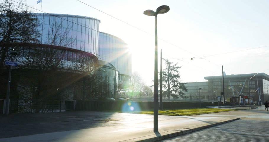 european court of human rights : STRASBOURG, FRANCE - DEC 25, 2015: Large building of the European Court of Human Rights building in Strasbourg, France on a warm summer day with people going to work