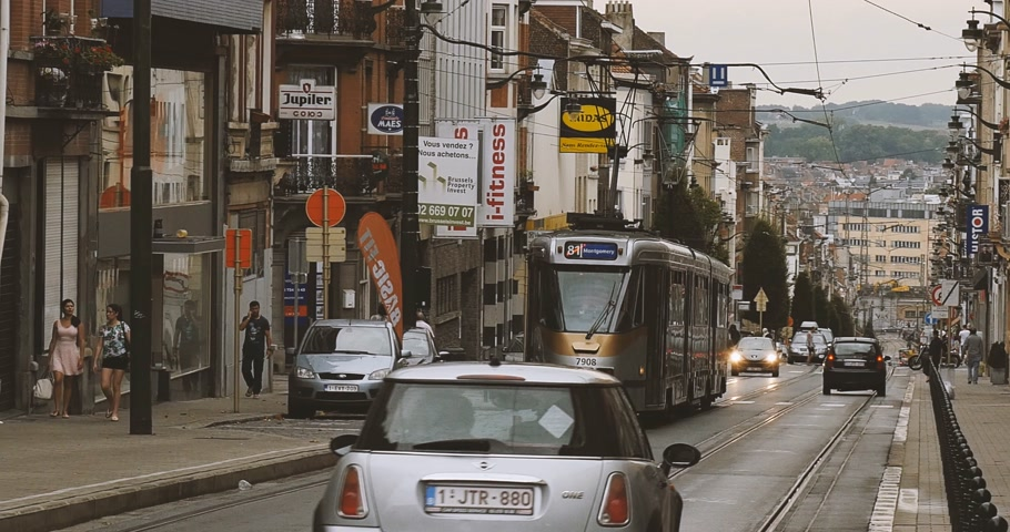 emissions : BRUSSELS, BELGIUM - CIRCA 2017: Tramway number 81 with destination Montgomery stop at the red light - rush hour on Brussels streets with cars and commuters Stock Footage