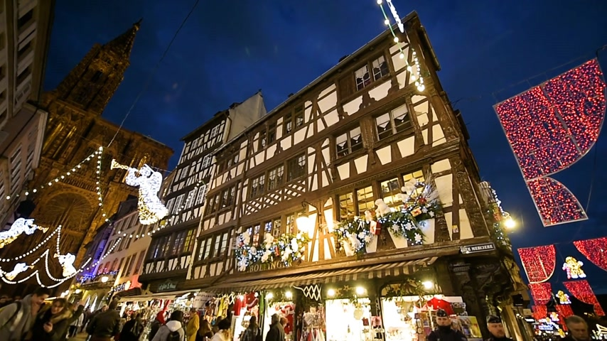 sheriff : STRASBOURG, FRANCE - DECEMBER 2016: Police officers from CRS Police Nationale surveillance of the Christmas market from the police van on the Rue Merciere street with the majestic Strasbourg Notre-Dame cathedral during Christmas holidays and Christmas Mar Stock Footage