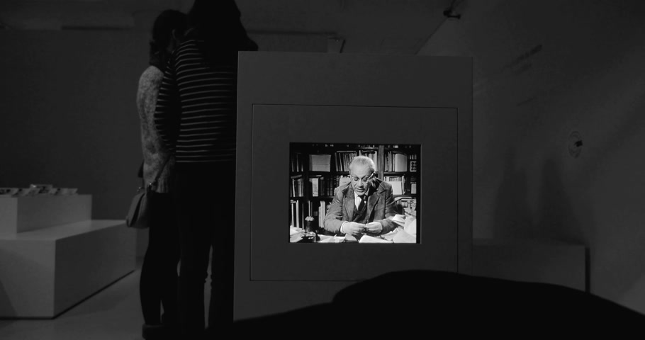 lógica : STRASBOURG, FRANCE - CIRCA 2017: Tristan Tzara talking from old TV at the Museum of Modern and Contemporary Art exhibition lHomme approximatif.  . Tristan Tzara was a Romanian and French avant-garde poet, essayist and performance artist. Stock Footage