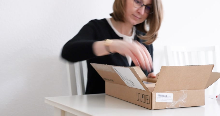 microélectronique : PARIS, FRANCE - CIRCA 2017: Woman unboxing parcel containing Dell computer hardware part for her workstation - computer part replacement