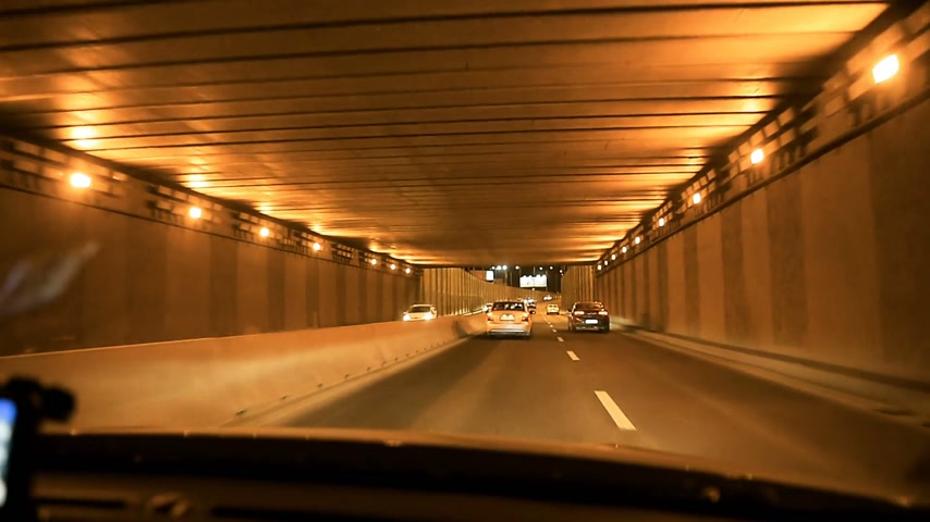 traffic bucharest : BUCHAREST, ROMANIA - CIRCA 2016:  Night driving - entering in the the new tunnel in Bucharest, Romania. Stock Footage