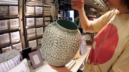 для продажи : Arteixo, Spain - Circa 2017: Zara Home interior of modern home decoration store with woman buying as a gift or for decoration traditional designer patio terrace Indian lantern Стоковые видеозаписи