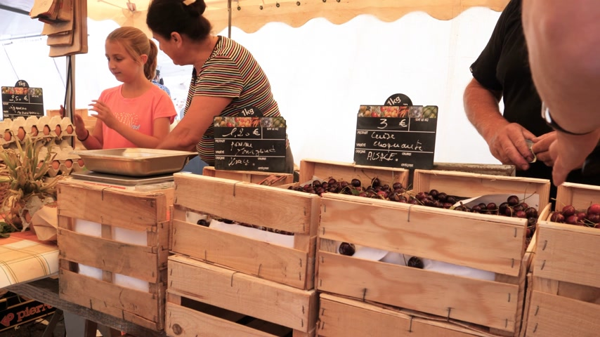grande grupo de objetos : Strasbourg, France - circa 2017: Farmers selling cherries to customers at the traditional French farmer market in Strasbourg - buying Alsace cherries organic bio food